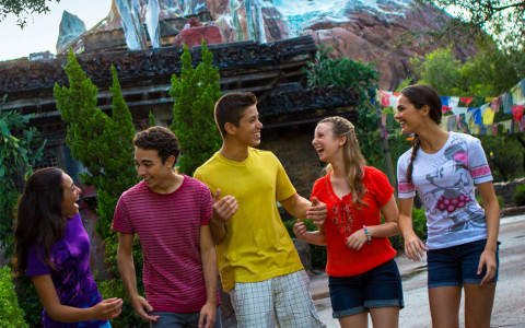 teenage friends laughing together at Disney's Animal Kingdom