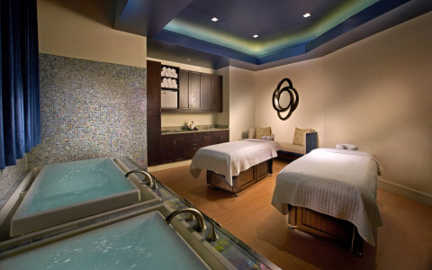 interior spa image with massage tables and baths under soft lighting