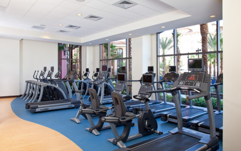 fitness center with treadmills looking out bay windows