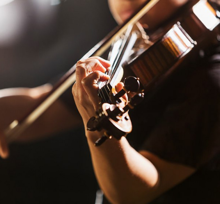 close up of a violinist playing a violin