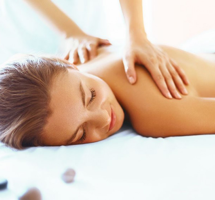 woman receiving a massage at a spa