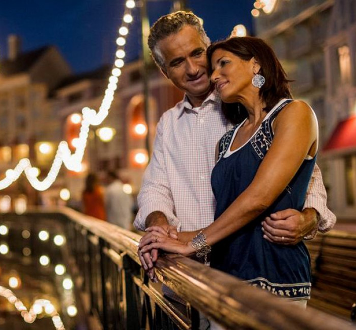 Couple embracing on Disney's Boardwalk