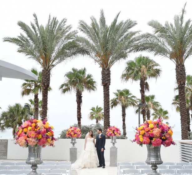 Wedding couple with palm trees in the back