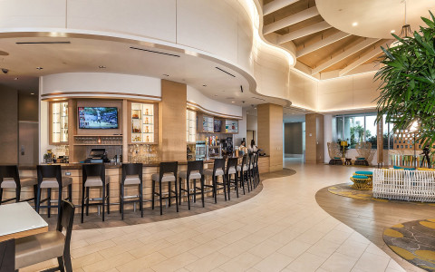 Hotel lobby with bar and stool seating
