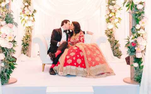 Wedding couple sitting on couch onstage