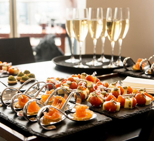 champagne flutes on a tray with appetizers