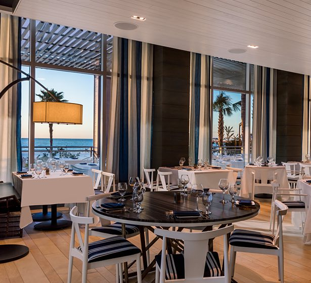Dining area with tables, chairs & ocean view