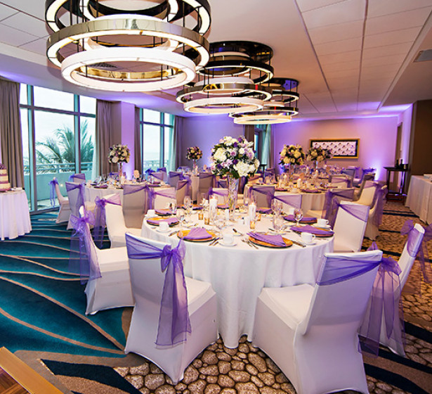 white chairs with purple ribbon