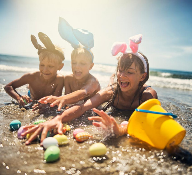 kids playing on the beach with easter eggs