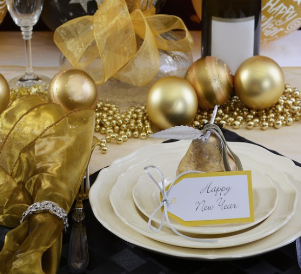 new years eve dinner set up with golden ornaments