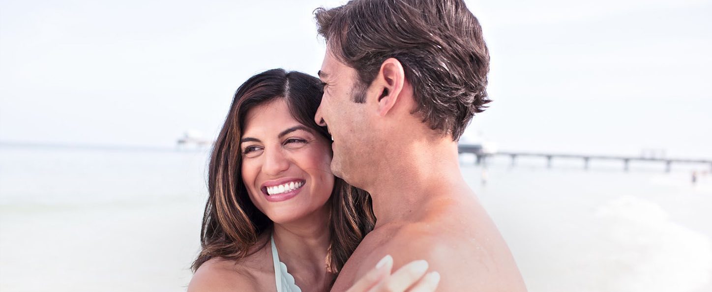 Couple smiling by the ocean