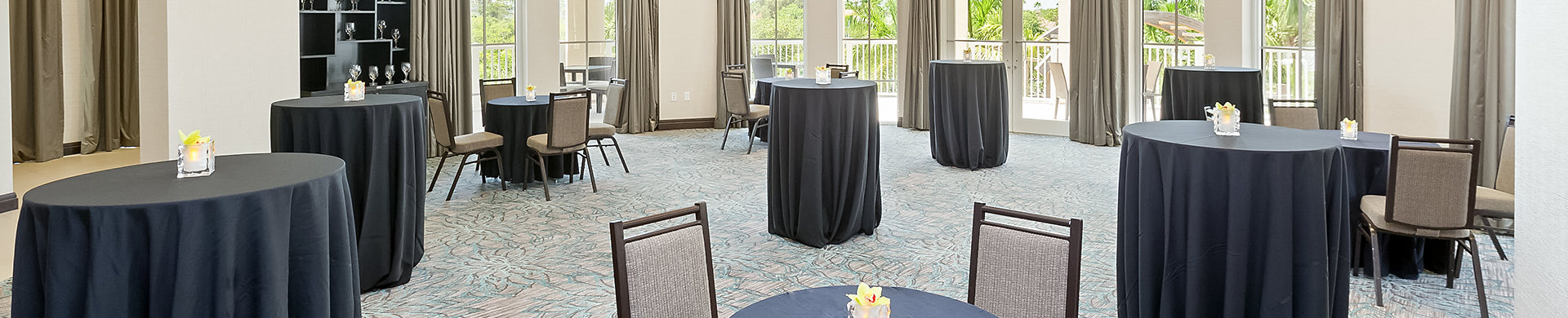 event space with small tall round tables
