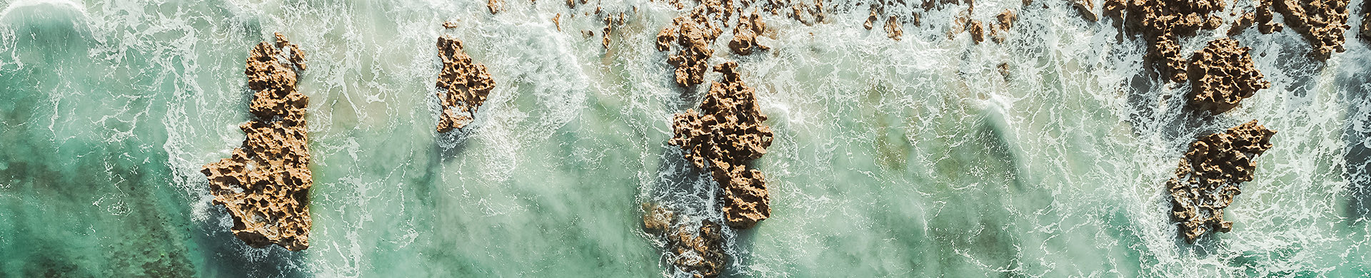 aerial view of ocean and rocks