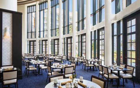 floor to ceiling windows inside view of a fancy restaurant