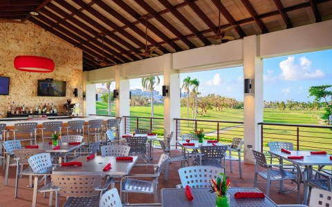 outdoor dining overlooking a golf course