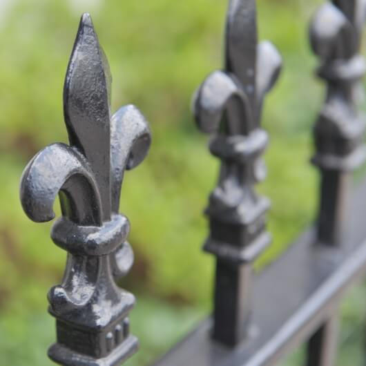 fence with fleur de lis accents