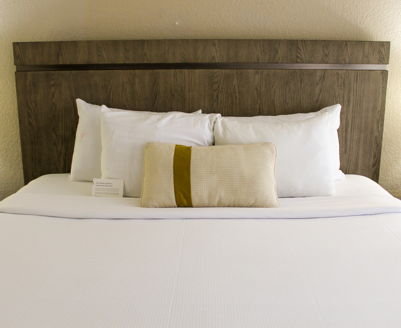 hotel bed with decorative pillows