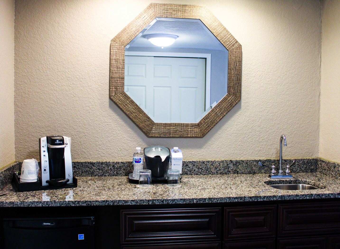 table with a sink and a coffeemaker/ keurig station