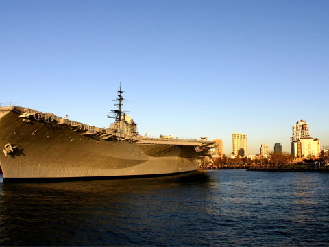 Aircraft carrier docked in San Diego Bay