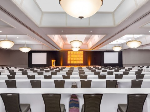 Pacific Ballroom conference space with a large stage and screens