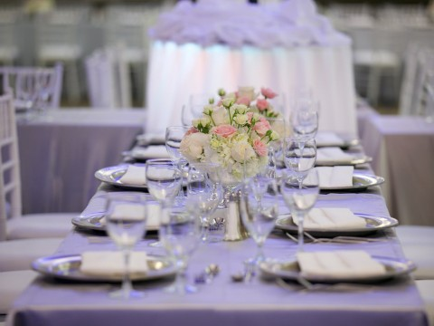 Wedding table setting with white and pink flowers