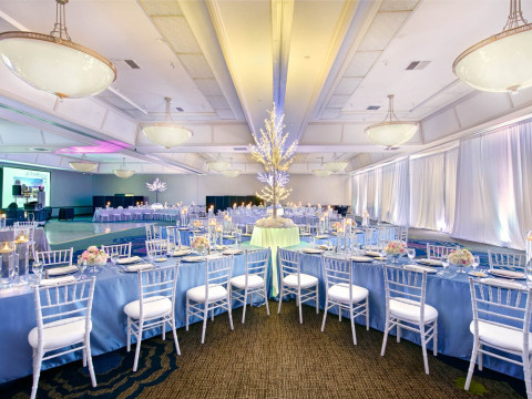 Special events room setup with tables and chairs and large lit centerpiece