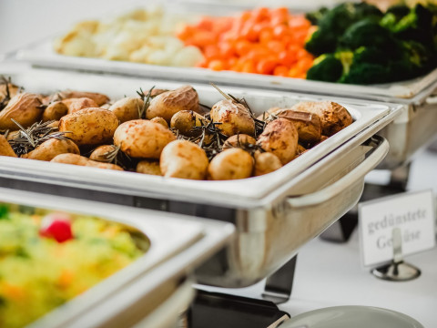 silver catering trays with potatoes and vegatables