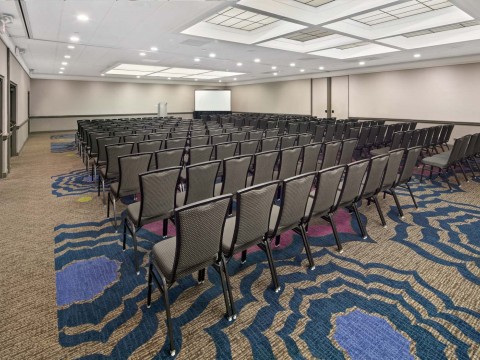 Coast Ballroom meeting space with chairs and a screen