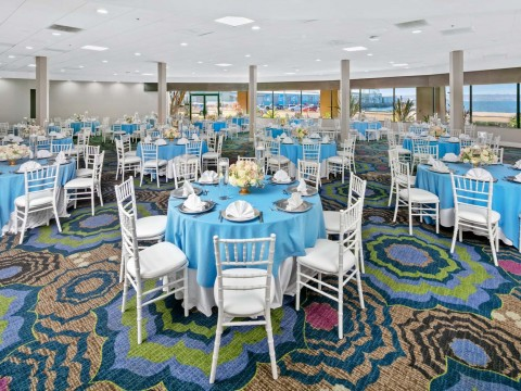 Harborside venue space decorated with blue and white accessories