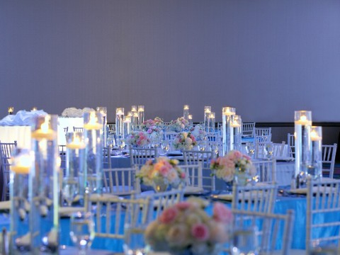 ballroom decorated with pink and white flowers