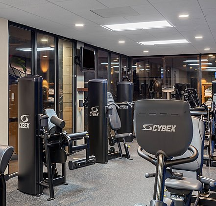 exercise room with various work out equipment