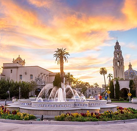Balboa Park fountain with buildings at sunset
