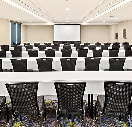 Bayroom room setup with tables and chairs for a meeting