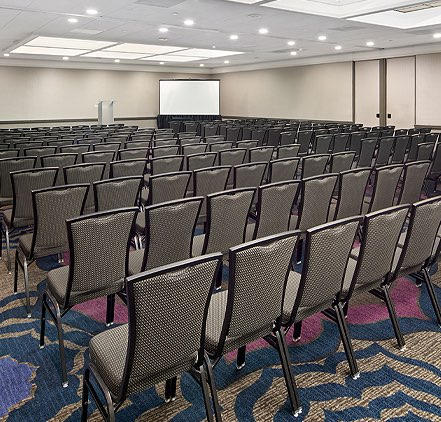 Coast Ball Room setup for a meeting with rows of chairs and seating