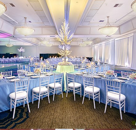 Pacific Ball room with table and chair seating arrangement with large lighted tree centerpiece