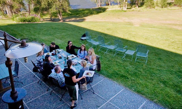Outdoor dining patio overlooking a large field