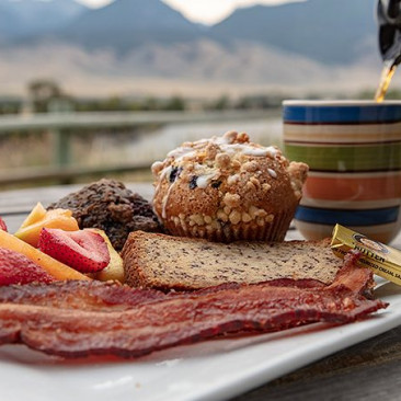 breakfast with muffin fruit and bacon