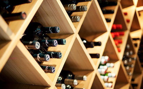 Numerous bottles of wine stored in cubby holes