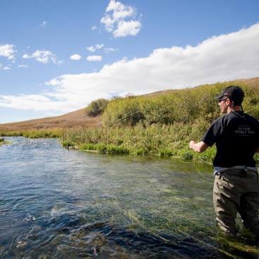 Man standing in the river fly fishing