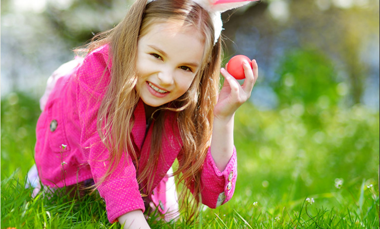 Young girl searching for easter eggs