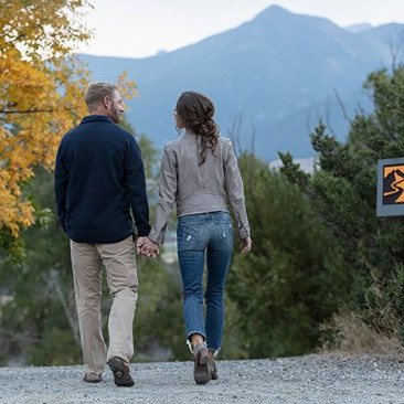 couple walking along yellowstone trail