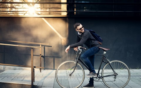 man smiling on bike