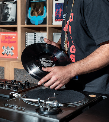 person with dj discs