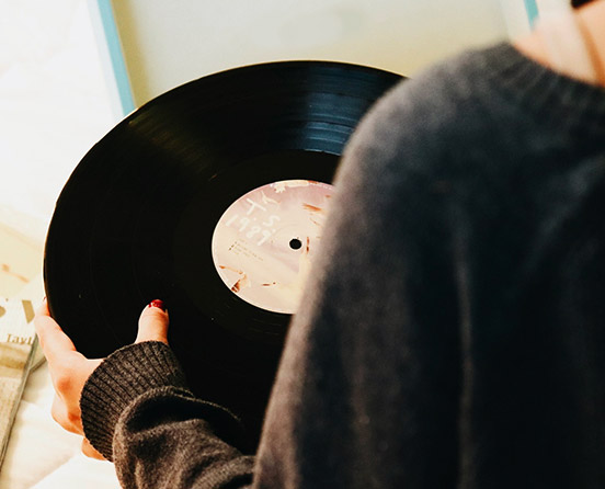 person holding a record