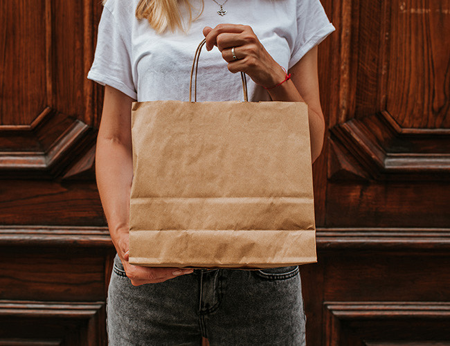 woman holding takeout bag