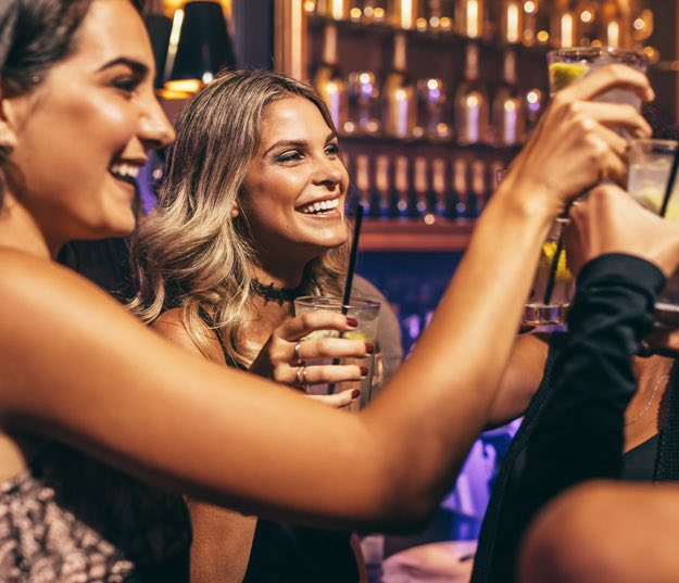 Women having fun at bar
