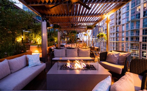 cozy rooftop terrace seating with fire pit