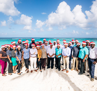 Zemi Beach House Staff wearing christmas hats on the beach