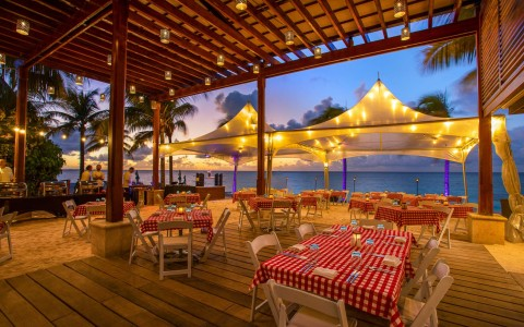 outdoor seating area overlooking the ocean with market lights hanging on the gazebo