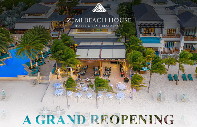 Aerial view of zemi beach house with text saying A Grand Reopening
